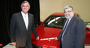 Holden Commodore EVElectric dreams: EV Engineering chairman Rob McEniry (left) and federal industry minister Kim Carr at EV Engineering's February launch.