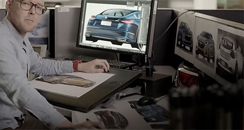 Holden 2017 Commodore Screen sirens: A Holden designer sits before an array of images showing a Holden-badged concept vehicle that could replace the Commodore large car once production ends.