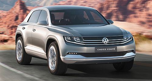 Volkswagen 2014 Tiguan Evoquetive: VW's Cross Coupe concept has shades of Range Rover's Evoque, with its low and wide stance.