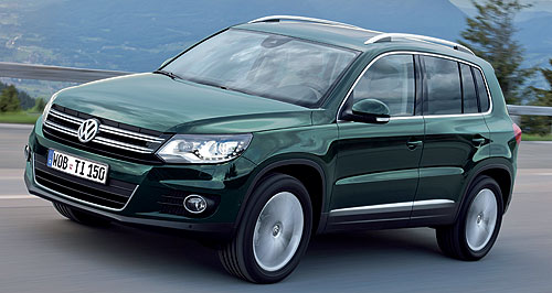 Volkswagen 2011 Tiguan Revised design: The new Tiguan is distinguised by a Toureg-like front end, with the now signature VW 'letterbox grille' and more angular headlights.