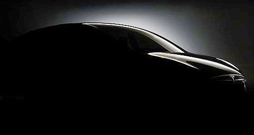 Tesla 2014 Model X Smooth: This teaser image of the Tesla Model X suggests it will be much more stylish than rival SUVs.
