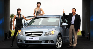 Daewoo  Brave face: GM Daewoo president and CEO Michael Grimaldi launches the new Lacetti in Seoul.