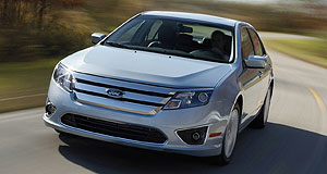 Ford  Upward: The Ford Fusion Hybrid is one of a range of fuel-efficient vehicles from the Blue Oval that have helped profit levels skyrocket so far this year.