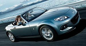 Mazda 2013 MX-5 Family smile: The Mazda roadster's revised front fascia adopts the look of the new CX-5 SUV.