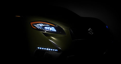 Suzuki 2013 S-Cross Sketchy details: If this teaser image is any indication, the forthcoming Suzuki S-Cross SUV will take the company in a sportier design direction.