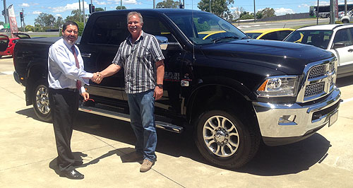 Ram  First one: Queenslander Brent McDonald takes delivery of the first American Special Vehicles-converted Ram from Yamanto dealer Glen Stallard.