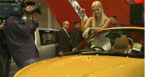 Daihatsu Copen Tiny topless: Sophie Monk takes delivery of her new Daihatsu Copen at the Sydney show.