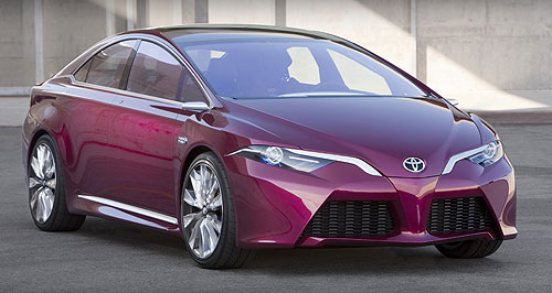 Toyota 2015 NS4 Revealed: The coupe-like Toyota NS4 plug-in hybrid sedan concept on the Detroit show stand.