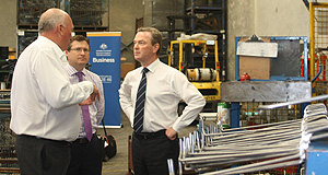 General News Government Product boost: Christopher Pyne (right) with Multislide Industries managing director Rod Rebbeck (left) and federal member for Hindmarsh Matt Williams.