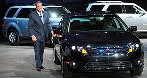 Ford  Here they come: Bill Ford with the 2010 Ford Fusion Hybrid - typical of the 'green' vehicles in Ford's future.