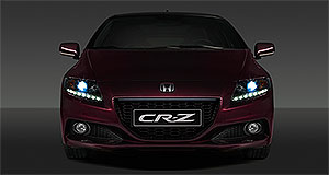Honda 2013 CR-Z Bar and grille: Honda has enlarged the facelifted CR-Z's radiator grille while cleaning up the design by removing the horizontal bars from behind the numberplate.