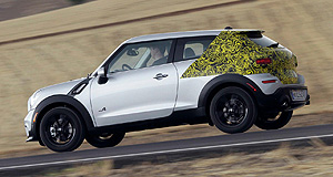 Mini 2013 Paceman Camo coupe: Mini has hidden the Paceman's rear-end styling in its first official images of the car but shown the world that its coupe-like SUV will share a face with the related Countryman.