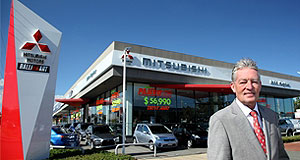 General News  Winners are grinners: Gary Fitch from John Hughes Mitsubishi in Perth has been named Mitsubishi's 2011 Metropolitan Dealer of the Year.
