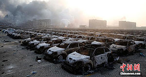 General News  Car smash: Thousands of burned out imported cars litter port holding yards at Tianjin after Wednesday night's explosions. Pictures: Chinanews.com.