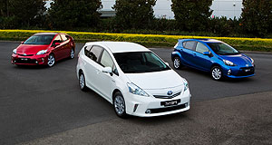 Toyota  Tricolour trio: The new Prius V (white) and C (blue) with the standard Prius hatchback (red).